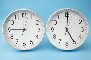Office Clocks Showing Different Times --- Image by © Royalty-Free/Corbis